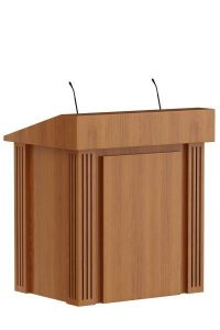 Klassiek spreekgestoelte in hout. De lijnen in het massieve hout op de hoeken geven het spreekgestoelte karakter. Classic lectern in wood. The lines in the solid wood on the corners give the lectern character.   Klassisches Rednerpult in Holz. Die Linien im Massivholz an den Ecken verleiht das Rednerpult Charakter.