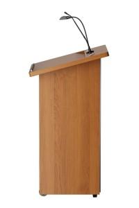Stijlvol houten spreekgestoelte met strakke lijnen. Het schuine leesvlak heeft een papierstop en voldoende ruimte voor papier of tablet onder de shock mount. Optioneel is een LED leeslamp met schakelaar.  Stylish wooden lectern with sleek lines. The inclined reading surface has a paper stop and sufficient space for paper or tablet under the shock mount. Optional available is a LED reading light with switch.   Stilvolles Rednerpult aus Holz mit glatten Linien. Die geneigte Lesefläche hat einen Papierstopper und bietet ausreichend Platz für Papier oder Tablette unter dem Erschütterungsabsorber. Optional ist eine LED Leseleuchte mit Schalter erhältlich.